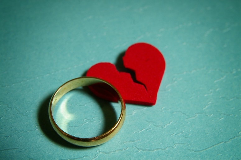 A wedding ring and broken heart representing divorce