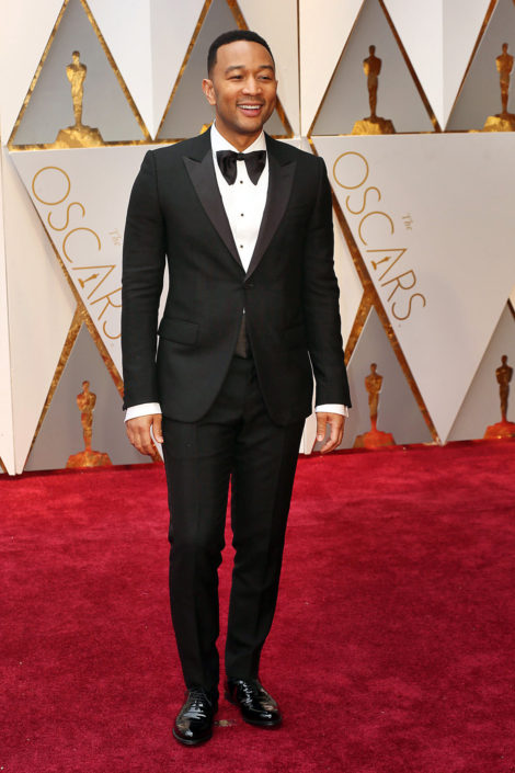 John-Legend-wearing-a-70s-inspired-huge-floppy-bow-tie-with-peaked-lapel-1-button-tux-with-flap-pockets-and-patent-leather-captoe-Oxfords.-Note-his-sleeves-are-too-long--470x705 (1).jpg
